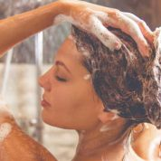 When should you shower after tanning?